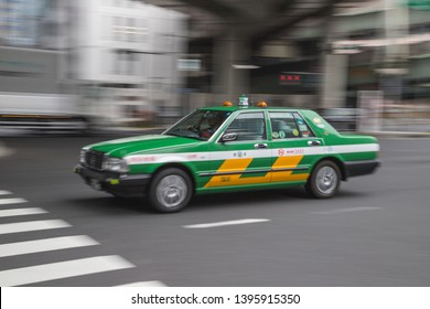 TOKYO, JAPAN - 12TH JANUARY 2019: A typical taxi on a road in Tokyo during the day