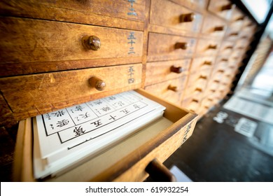 "Tokyo, Japan - 15 March 2017: Omikuji (Paper Fortune) in a drawer at Senso ji. ""Omikuji"" is a strip of paper that predicts your fortune when you make a prayer to the gods and buddhas."
