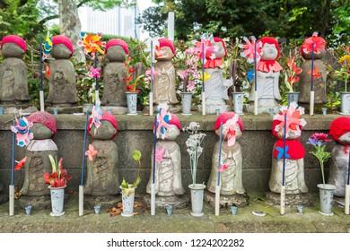 tokyo, japan. 16th august, 2018: colorful jizo statues row