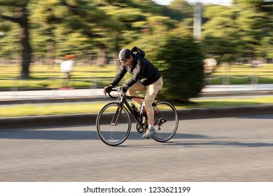 Tokyo , Japan 18 Nov 2018 - asia man riding bicycle in the park.