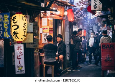 TOKYO, JAPAN - 20 APRIL, 2018: People dine at one of the izakayas - japanese pub, in Shinjuku district in Tokyo, Japan.
