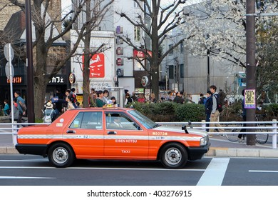 TOKYO, JAPAN- 2015, February 22: Unidentified taxi and unidentified people at Harajuku street in Japan on February 22, 2015.