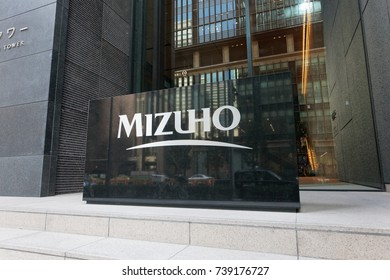 Tokyo, Japan 2016: Mizuho Bank headquarters sign at the entrance of the Otemachi Tower.