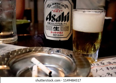 TOKYO JAPAN. 2018 July 27th. Drinking Asahi Super Dry Beer with Cigar Ashtray.