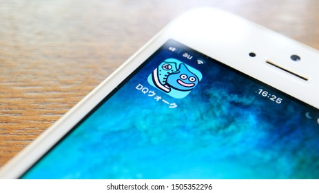 TOKYO, JAPAN. 2019 Sep 16th. Close up the Dragon Quest Walk Logo and Icon on Smartphone Display