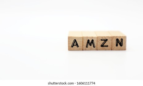 TOKYO, JAPAN. 2020 Jan 5th. Wooden Text Block of AMZN on Isolated Background