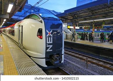 TOKYO, JAPAN -21 FEB 2019- View of the high speed Narita Express international airport access train (NEX) by JR East Japan Railway Company connecting Narita Airport (NRT) to Central Tokyo.