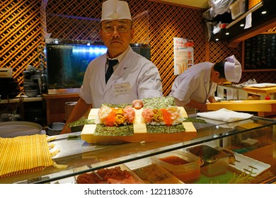 TOKYO, JAPAN -22 OCT 2018- View of a sushi chef offering an omakase sushi menu in a Japanese restaurant in Tokyo, Japan.