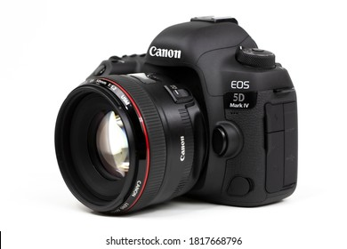 Tokyo, Japan 22.04.2020 - DSLR camera Canon Mark 5D IV with Canon EF-50mm 1.2 USM lid-opened lens isolated on white background