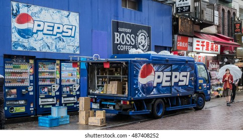 TOKYO, JAPAN - 22ND SEPTEMBER 2016. Pepsi delivery truck stopping in the street of Shibuya, Tokyo during a rainy day.