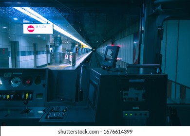 Tokyo, Japan- 23 February 2020: Control panel systems of a train in Tokyo, Japan. Train interior in Tokyo train and driver seat. Train control room with light at the tunnel.