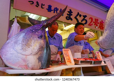 TOKYO, JAPAN -23 OCT 2018- View of a fishmonger butchering giant tuna fish in the area around the former Tsukiji fish market, which moved to Toyosu in October 2018.