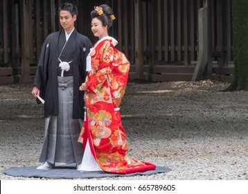 TOKYO, JAPAN - 24TH JUNE 2017. Japanese wedding at Meiji Jingu temple ground. The shrine is a popular site for marriage ceremonies and on busy weekends, it carries out around 15 weddings a day.