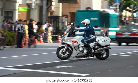 TOKYO, JAPAN - 26 MAY 2019 : TOKYO METROPOLITAN MOTORCYCLE POLICE OFFICERS patrol around for U.S. President Donald Trump`s arrival at Ryogoku Kokugikan to watch the grand sumo tournament.