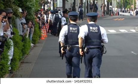 TOKYO, JAPAN - 26 MAY 2019 : TOKYO METROPOLITAN POLICE OFFICERS patrol around for U.S. President Donald Trump`s arrival at Ryogoku Kokugikan to watch the grand sumo tournament.