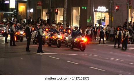 TOKYO, JAPAN - 26 MAY 2019 : TOKYO METROPOLITAN MOTORCYCLE POLICE OFFICERS waiting for U.S. President Donald Trump`s motorcade to depart Roppongi after having a dinner with Japanese Prime Minister.