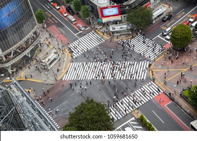 Tokyo, Japan - 26th June 2016: Ariel view of the busy Shibuya Crossing, known as The Scrambles, where upwards of 1000 people cross the street every time the lights change.