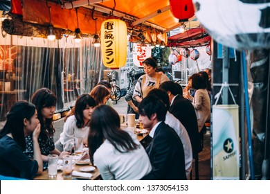 TOKYO, JAPAN - 27 APRIL, 2018: People enjoy their lunch at Hoppy Dori street market in in Asakusa district of Tokyo, Japan.