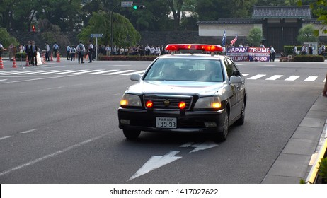 TOKYO, JAPAN - 27 MAY 2019 : Police car in front of the hotel where U.S. President Donald Trump and First Lady Melania stays during the visit in Tokyo.