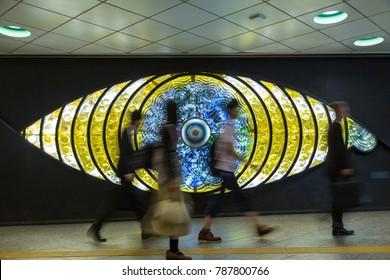 Tokyo, Japan - 27th June 2016: People walking in front of the Shinjuku or Tokyo Eye, a glass sculpture  at Shinjuku train station created in 1969 by artist Miyashita Yoshiko.