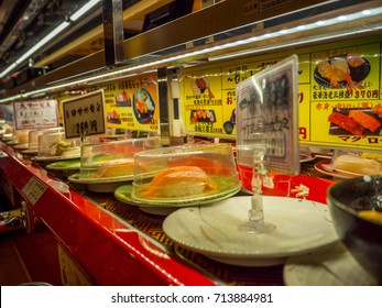TOKYO, JAPAN -28 JUN 2017: Close up of assorted japanesse food over a table, inside of a kaitenzushi conveyor belt sushi restaurant in Tokyo