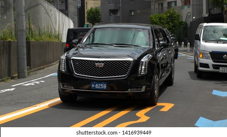 """TOKYO, JAPAN - 28 MAY 2019 : U.S. presidential Cadillac limousine (known as """"The Beast"""") is seen leave from Akasaka Press Center.  President Donald Trump is not on the vehicle."""