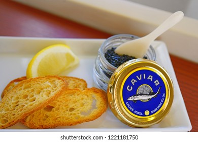 TOKYO, JAPAN -3 NOV 2018- Platter with a container of expensive Crown Jewel black sturgeon caviar, blinis and accoutrements served in First Class on Japan Airlines JAL.