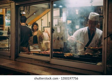 TOKYO, JAPAN - 30 APRIL, 2018: View of a busy kitchen of a yakitori restaurant in Ginza district of Tokyo, Japan.