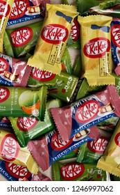 TOKYO, JAPAN - 30 NOVEMBER 2018: Different flavor Kit Kats in a pile. The brand is Japan's top selling confectionary, & there have been more than 300 limited-edition flavors since 2000. Editorial.