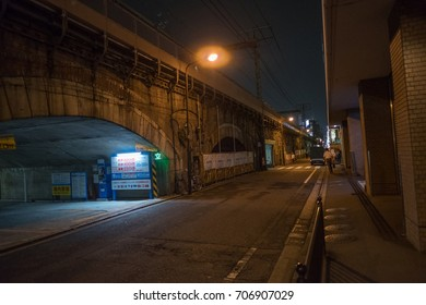 TOKYO, JAPAN - 30TH AUGUST, 2017. Yurakuchi back alley by the elevated rail track at night.