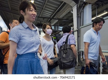 TOKYO, JAPAN - 30TH AUGUST, 2017. Commuters at the Tokyo Metro subway station platform.