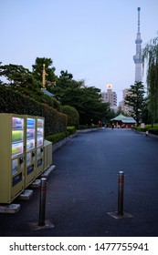 Tokyo / Japan - 31st July 2019: Asakusa district. Vending machines on the streets with the Tokyo Skytree in the background.