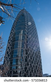 """TOKYO, JAPAN - 3RD FEBRUARY 2016. Back light shot of the """"Mode Gakuen Cocoon Tower"""" in Shinjuku, Tokyo. Shinjuku is a major commercial and administrative center in Tokyo."""