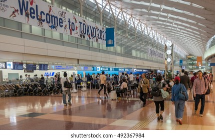 TOKYO, JAPAN - 3RD OCTOBER 2016. Travelers at the departure hall of Terminal 2, Haneda International Airport. Haneda is one of the two primary airports serving the Greater Tokyo Area, Japan.