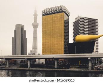 Tokyo, Japan - 4 December 2018 : Asahi Beer office building and Tokyo Sky Tree tower are popular landmark in Tokyo.