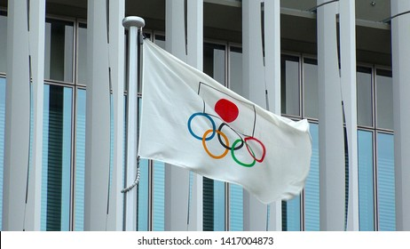 TOKYO, JAPAN - 4 JUNE 2019 : Flag of the five ring symbol of the Olympic Games and national flag of Japan at Japan Sport Olympic Square. Japan will host the Tokyo 2020 summer olympics.