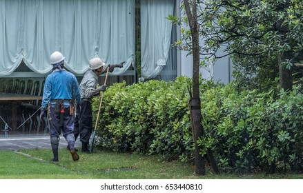 TOKYO, JAPAN - 4TH JUNE 2017. Workers working in a private residence. In Japan blue collar workers, skilled or unskilled on average works 40 hours a week from 9 am-5 pm with occasional overtime work.