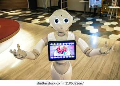 Tokyo, Japan 7 July 2017: Pepper Robot Assistant with Information screen. future of AI. Close-up of head Softbank Pepper robot on customer service. Pepper is a Artificial intelligence humanoid robot