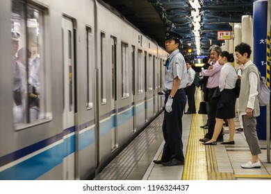 Tokyo, Japan 7 July 2017: People wait at Tokyo Metro station in Tokyo. Tokyo subway system is the busiest worldwide. Passengers traveling by metro. crowd Business people commuting by public transport