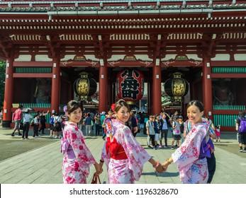Tokyo, Japan 7 July 2017: Three geishas wearing traditional japanese kimono among Sensoji Temple in Asakusa Tokyo, Japan. Young women wearing traditional Japanese Kimono traditional clothes in Japan