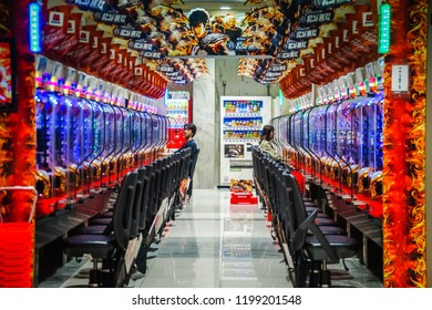Tokyo, Japan 7 July 2017: Young man plays video game in Tokyo arcade Pachinko Parlor in Akasaka. mechanical arcade game originating in Japan widely used as a recreational and gambling addiction