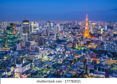 Tokyo, Japan aerial cityscape view of Tokyo Tower at dusk.