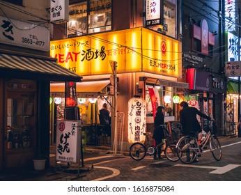 TOKYO, JAPAN - APR 14, 2019 : Restaurant Bar street with People in city Izakaya Tokyo Japan  Nightlife