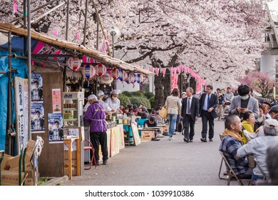 TOKYO, JAPAN - APRIL 1, 2017: People enjoy spring season by partaking in Soramachi Hanami festivals in Maruyama Park. The annual festivals coincide with the seasonal blooming of the cherry blossoms