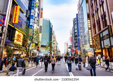 TOKYO JAPAN - APRIL 1, 2018 : Shinjuku neighborhood, Unidentified young tourists walk past this area has many shops full to shopping and restaurants. One of Tokyo's must-see places to visit.