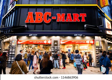 TOKYO JAPAN - APRIL 1, 2018 : Shinjuku neighborhood, Unidentified young tourists are choosing to shopping new shoes and have fun at ABC mart. One of Tokyo's must-see places to visit.