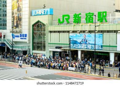 TOKYO JAPAN - APRIL 1, 2018 : Shinjuku neighborhood, Unidentified many travelers waiting walking to crosswalk the street to the JR. train station.
