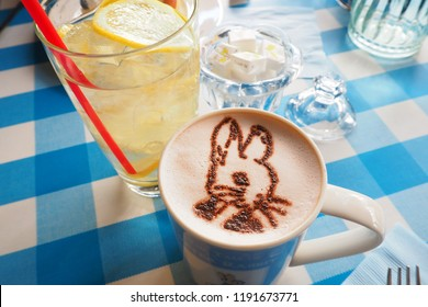 Tokyo, Japan - April 11, 2016, Peter Rabit latte art in hot coffee isolated on blue plaid table, Peter Rabbit Garden Cafe ,Jiyugaoka