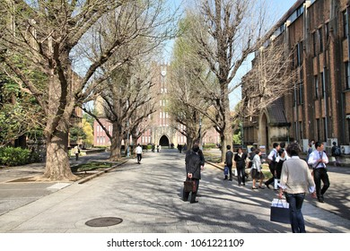 TOKYO, JAPAN - APRIL 12, 2012: People visit the University of Tokyo campus in Japan. The university is also known as UTokyo or Todai. It is located in Bunkyo ward.