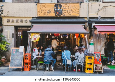 Tokyo / Japan - April 13 2019: people chilling outside on a sunny day in Asakusa